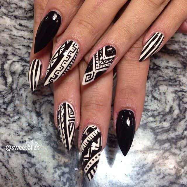 tribal black and white stiletto nail