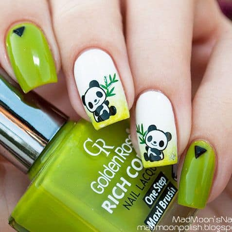 This design is so adorable. Two little pandas are giving a happy look  holding bamboo leaves on their hands. If you can do this designs properly,  ... - Panda Nail Designs: 21 Cutest Ideas For 2018 – NailDesignCode
