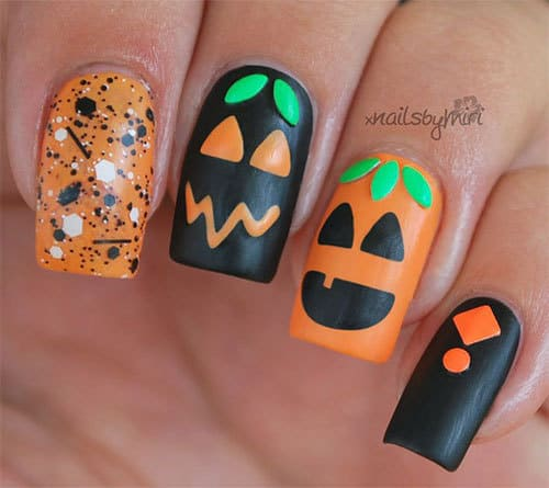 pumpkin nail art with glitters and stud