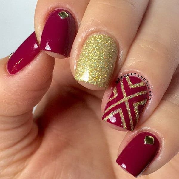 maroon red& gold nail idea