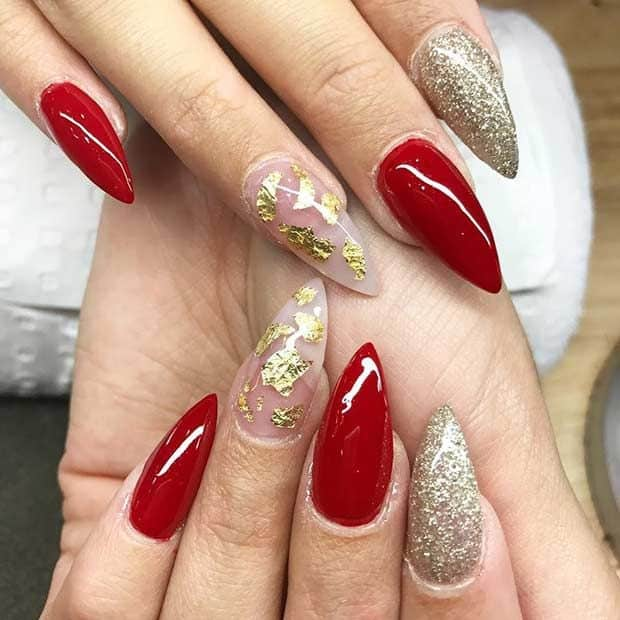 red and gold stiletto nail