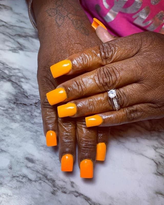 orange nail polish for dark skin