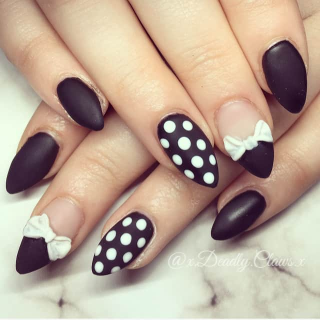 black nails with white polka dot and bow