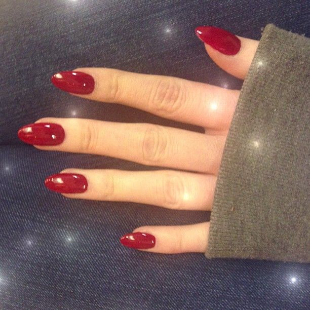red oval shaped acrylic nail