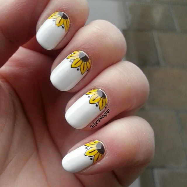 So, there's nothing wrong if you want to keep it simple and tidy. Design  your nails with simple sunflower art to ... - 10 Bright Sunflower Nail Arts To Look Beautiful – NailDesignCode