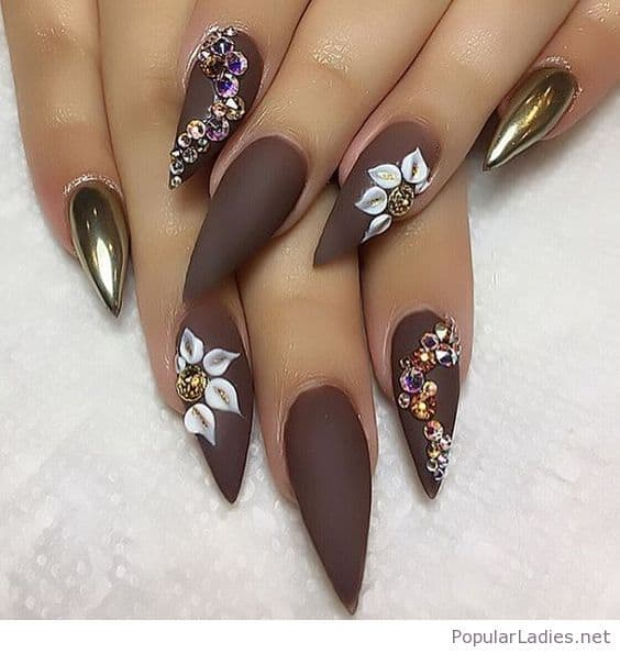 3D nail art is becoming popular these days. You can paint your brown nails  with 3D floral art to have this type of brown nail designs. - 20 Blissful Brown Nail Designs For Upcoming Fall Season