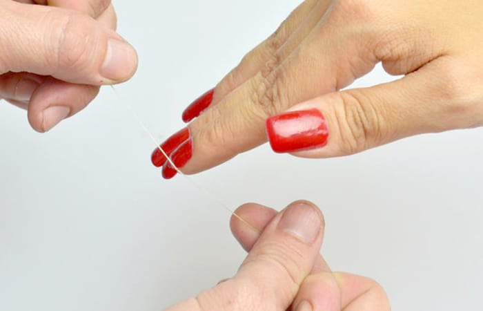 Remove Fake Nails using Dental Floss
