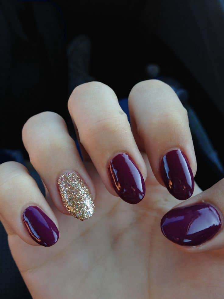 Burgundy oval shaped acrylic Nails