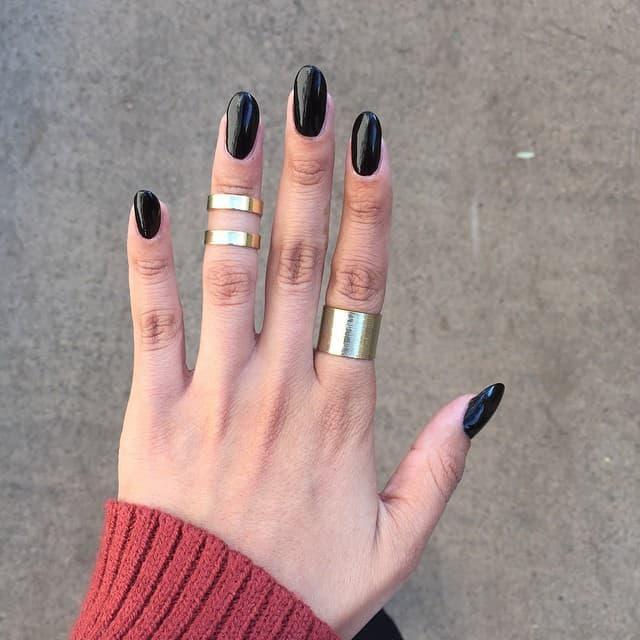 black oval shaped acrylic nail design