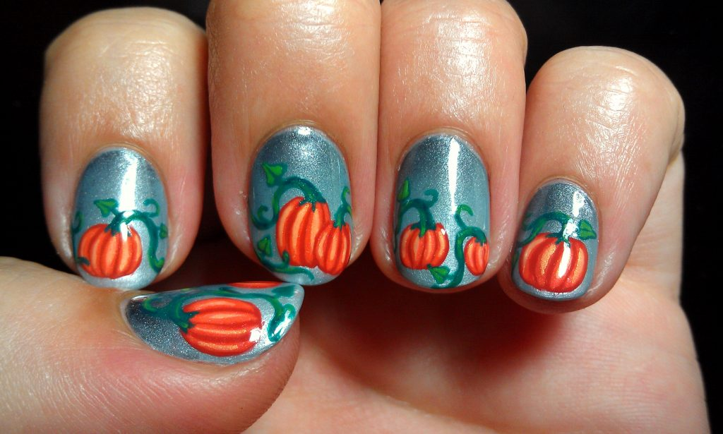 This silver nail design looks so real that you may feel natural pumpkin on  your nails. Pumpkins are drawn along with their green stems to give this  nail art ... - 15 Prominent Pumpkin Nail Art For Halloween – NailDesignCode
