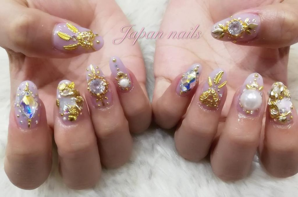Gold & stones in japanese nail design