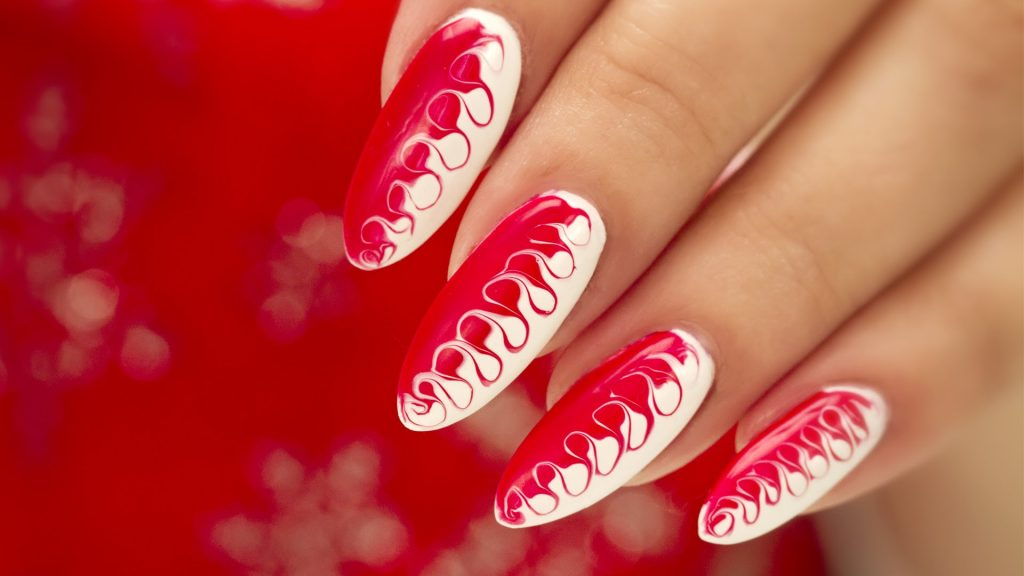 red and white swirl nail art