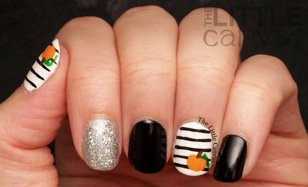 black and white pumpkin nails