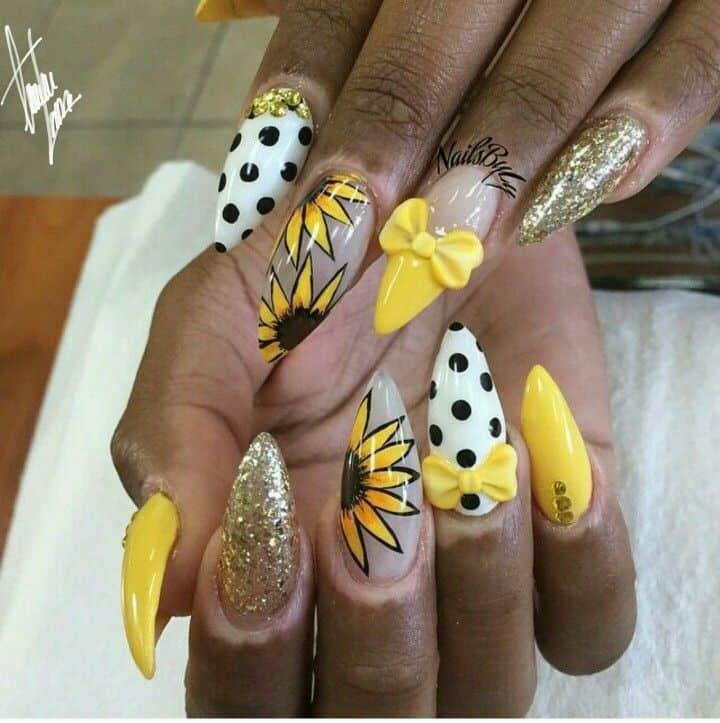 Yellow stiletto nail design