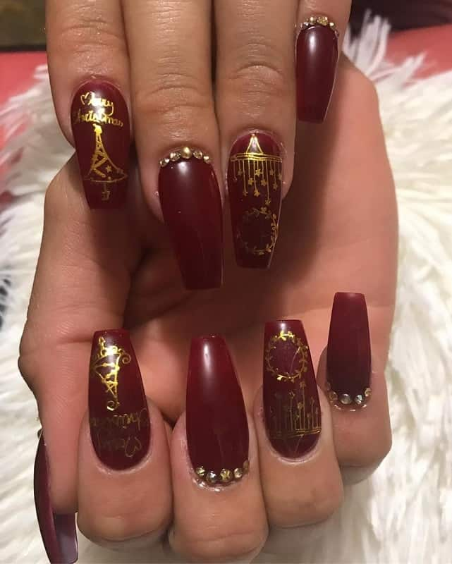 dark red and gold nails