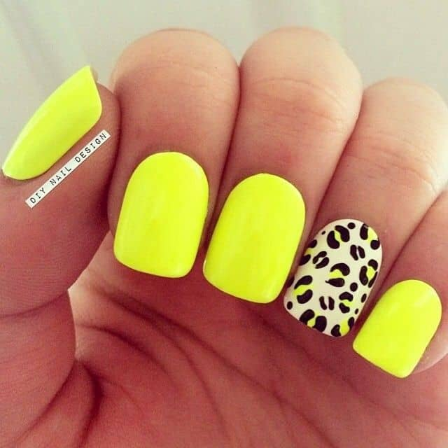 You can have neon yellow nail designs as summer nails. A leopard print will  add extra beauty to these nails. - 20 Bright Yellow Nail Designs For The Playful Hearts