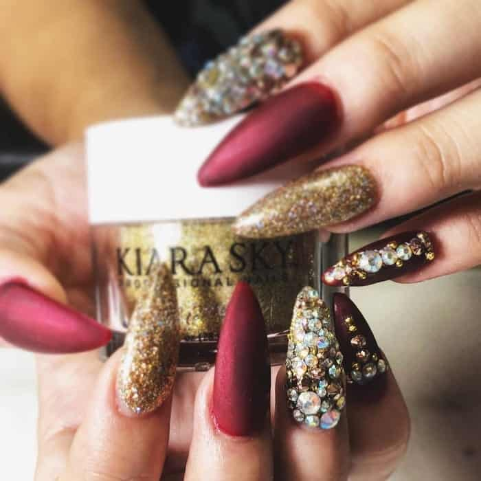 red and gold nails with diamond