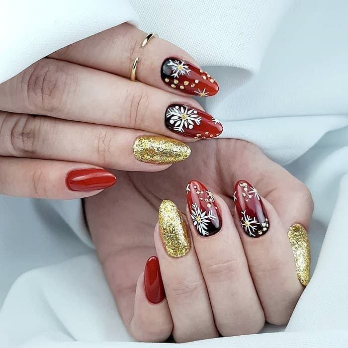 red, black and gold nails