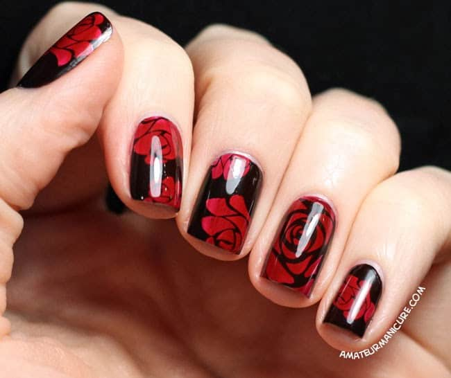 red rose on black nail