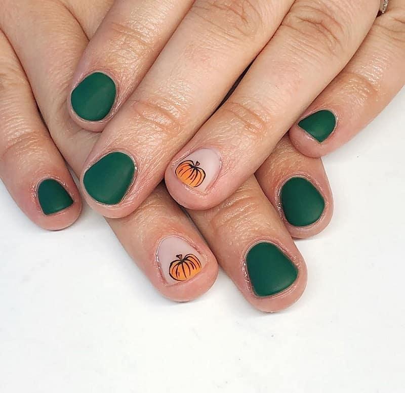 green nails with pumpkin