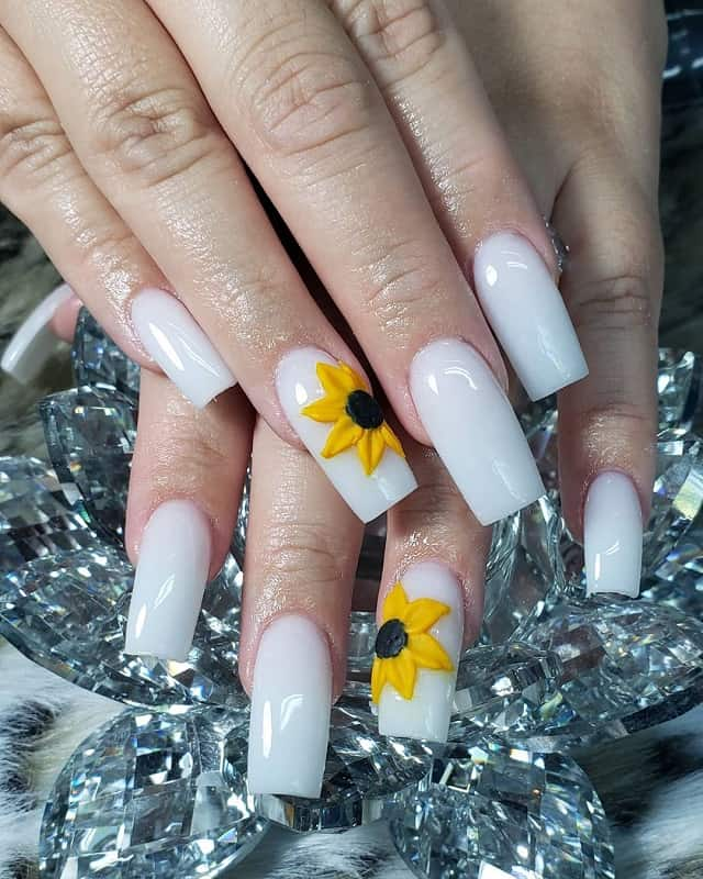 white nails with sunflower