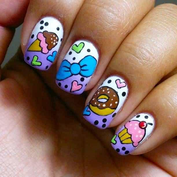 tooth cupcake nails