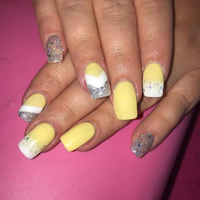 pastel yellow nails with glitter