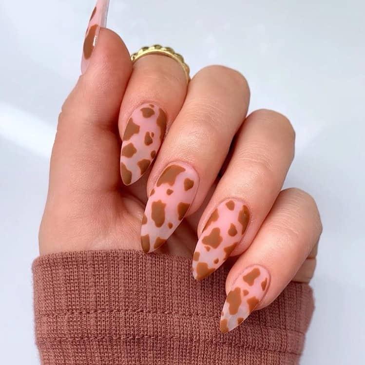 negative space cow print nail art