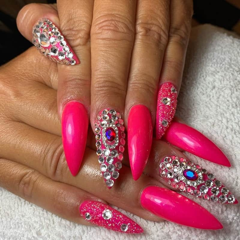 pointy nail design with diamonds