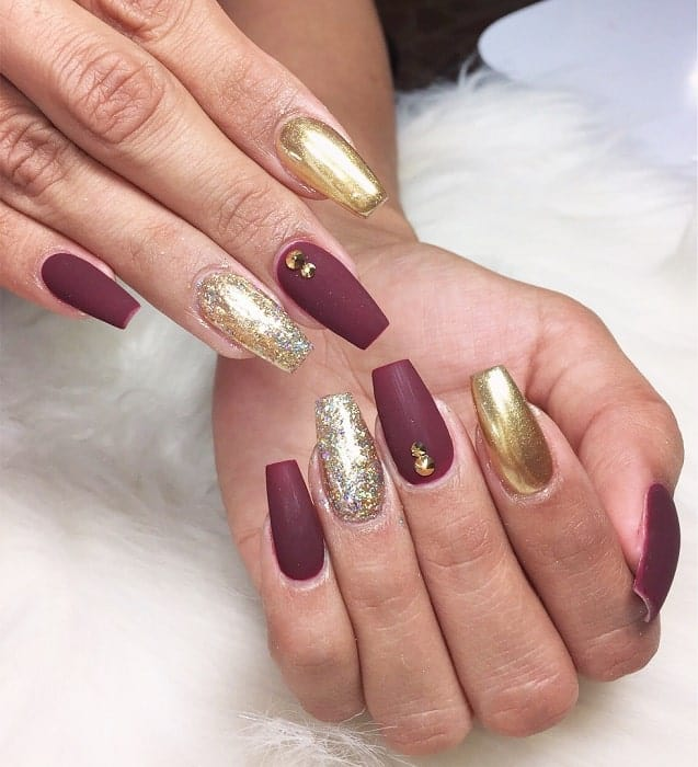 maroon and gold matte nails