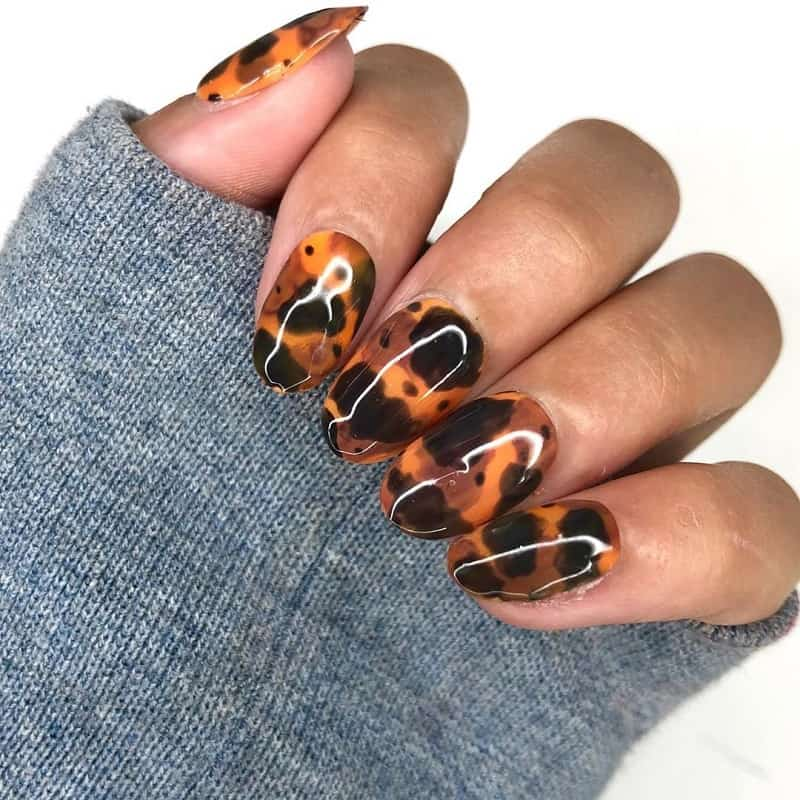 brown and orange nail design