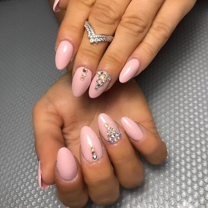 light pink nails design with diamonds