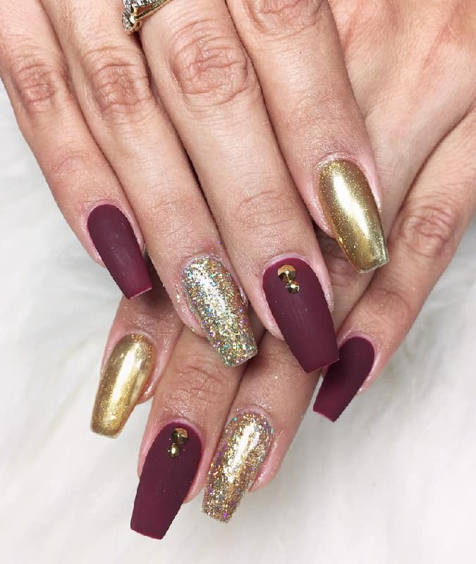 matte maroon nails with glitter