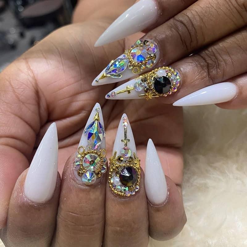 white nail design with rhinestones