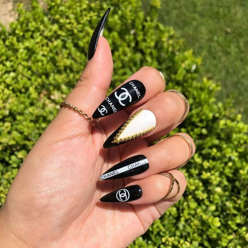 black white and gold stiletto nails