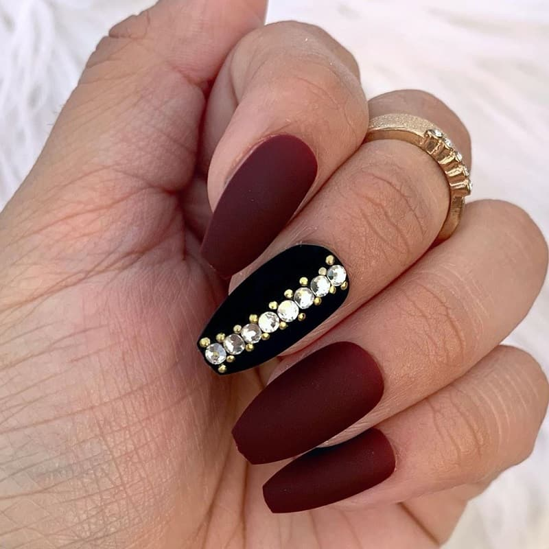 matte maroon nails with diamond