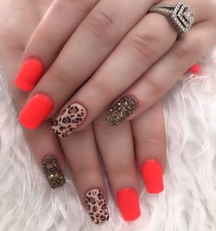 cheetah nail design with rhinestones