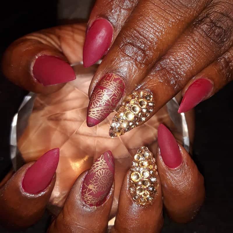 matte maroon nails on dark skin