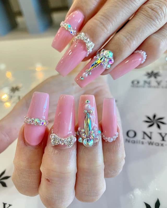 nails design with bow and rhinestones