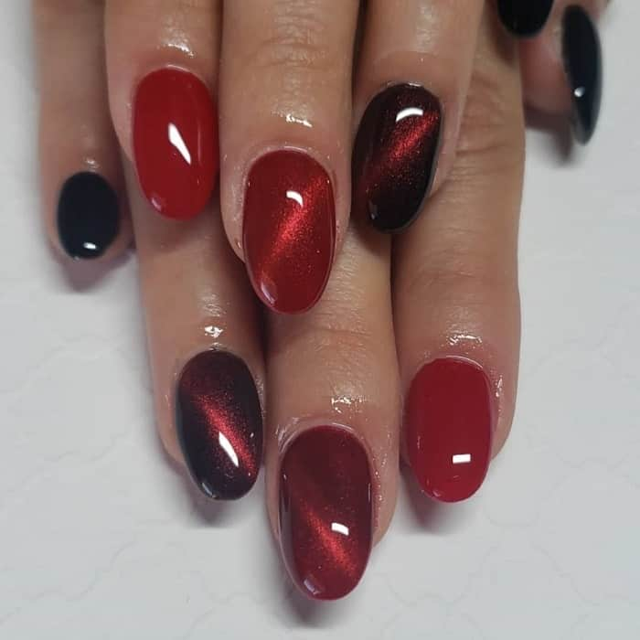 red and black cat eye nails