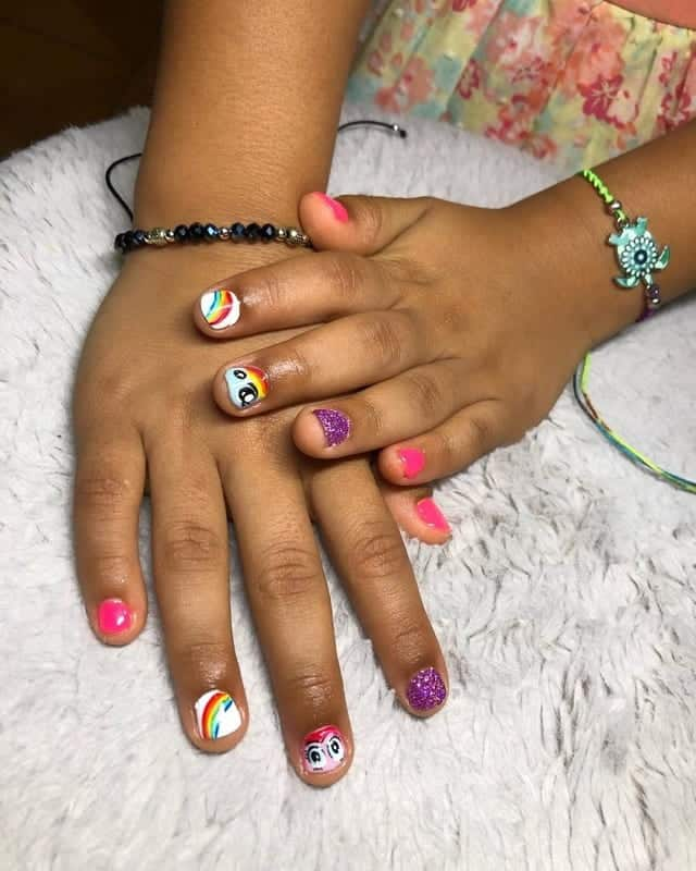 little girl with rainbow nails
