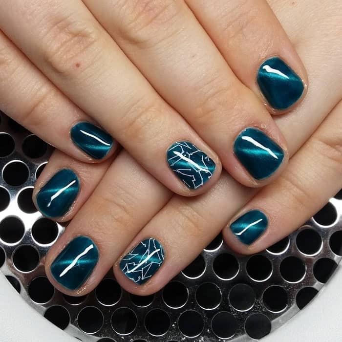teal cat eye nail design