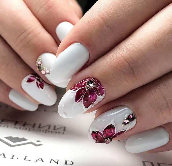 white and burgundy nail design