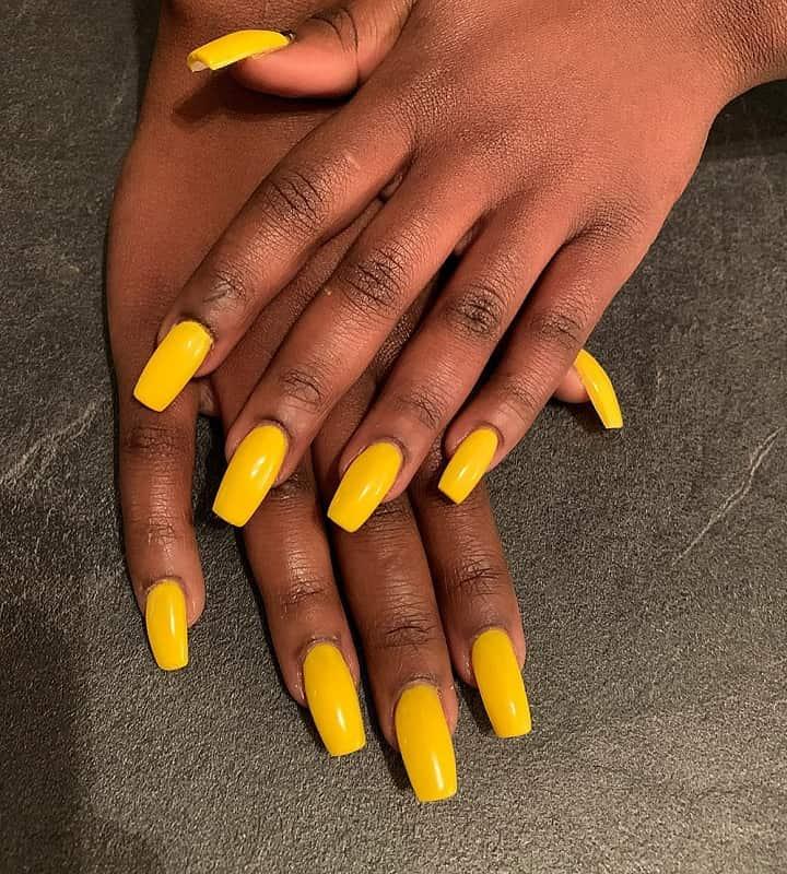 yellow nails on dark skin