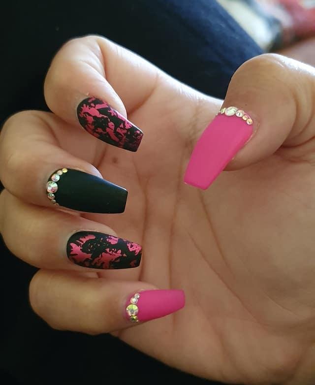 neon pink and blackl nail design