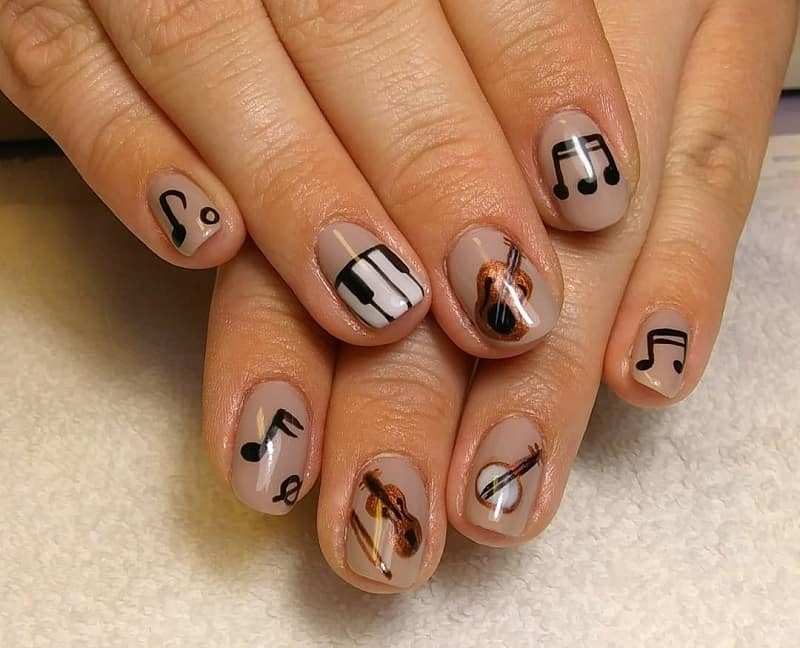 music notes on acrylic nails